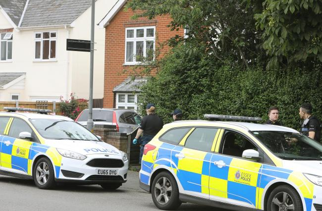 Police search a property in London Road, Copford.