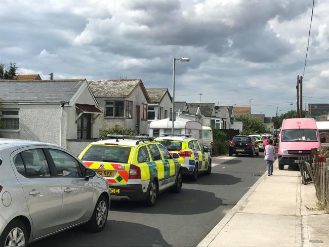 Police on scene after man found dead in bungalow