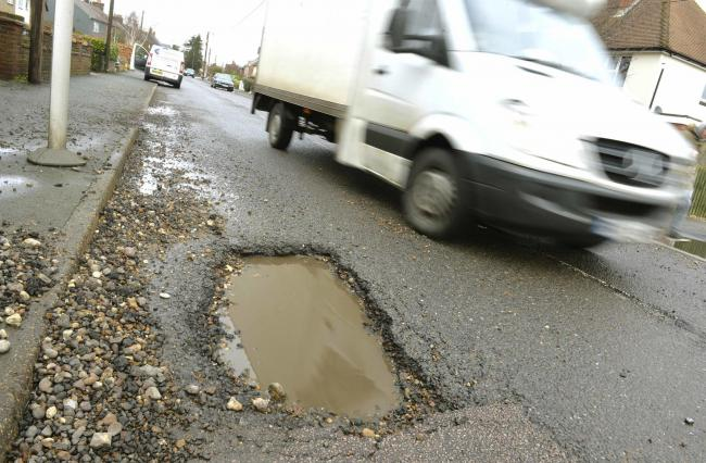 Payout - a pothole in Rectory Road, Wivenhoe