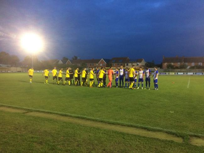 Before the lights went out - the Stanway and Clacton players shake hands before tonight's Essex Senior Cup tie. However, sadly, the match had to be abandoned after just ten minutes because of a floodlight failure.