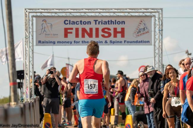 PERSONAL BEST: A Clacton Triathlon runner pushes himself across the finish line Photo by Kevin Jay