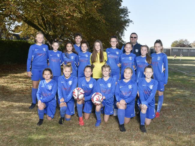 Frinton and Walton Youth FC's under-13s girls' team are celebrating receiving a Team Sports Award donation from UK Power Networks