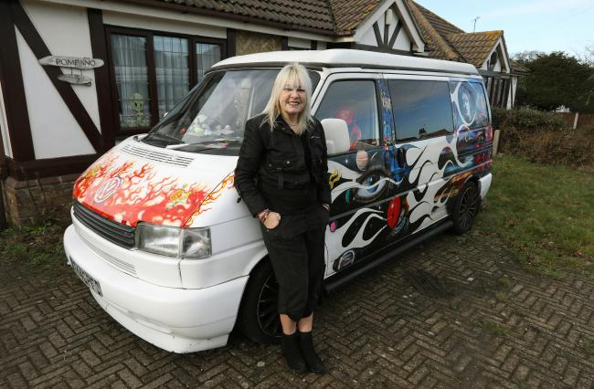 Jacqueline Huckle, from Holland, with her van being used to show off her artwork.