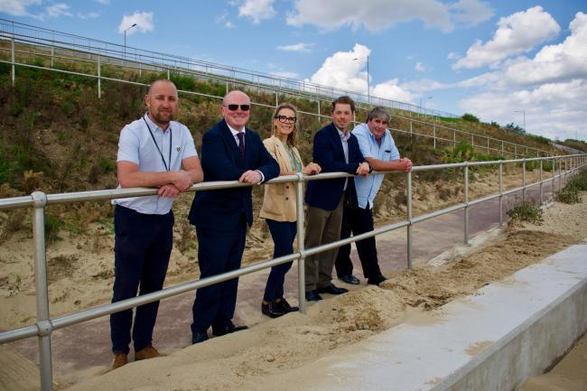 Tendring Council's Michael Cross and Paul Price Mott MacDonald's Clara Moreno, the council's James Ennos and Jackson Civil Engineering's Andy Wargent at the new accessible ramp in Holland-on-Sea