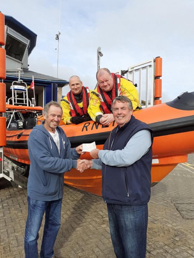 Cheque mates: Clacton seniors' captain Nigel Martin (front right) presents Clacton RNLI with a cheque for £150. This was from money raised earlier in the year following Nigel seniors' Guest Day.