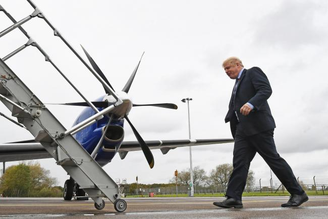 Boris Johnson boards a plane following a visit to the Tetley Tea factory in Stockton (Stefan Rousseau/PA)