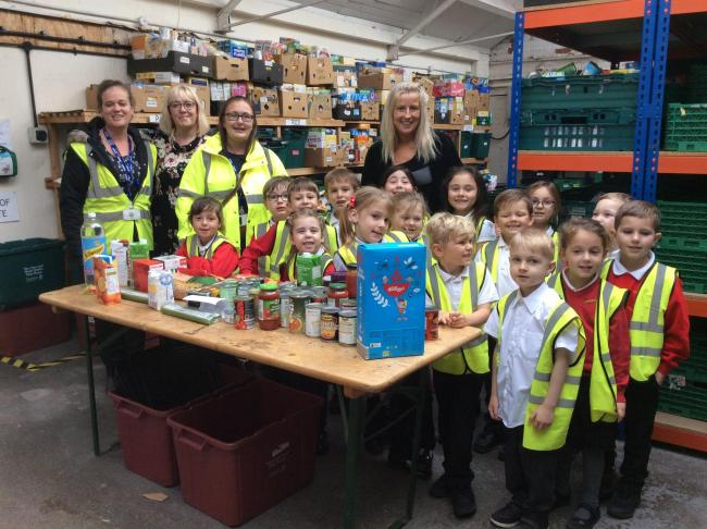 LITTLE HELPERS: Pupils from Oakwood Infant and Nursery School donated food to the Salvation Army's food bank