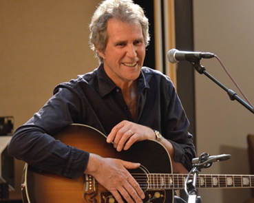 An Evening in Concert and Conversation with John Illsley, founder member of Dire Straits