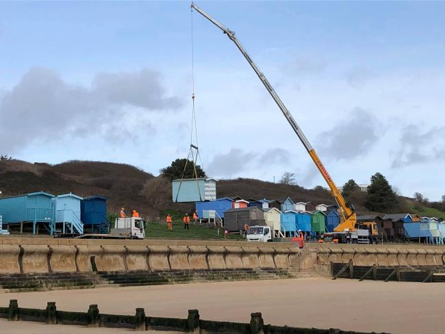 SKY HIGH: Some of the beach huts have been lifts by cranes and moved while workers rebuild the structure Picture: Nick Singleton