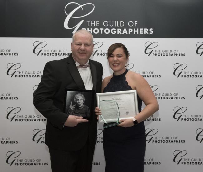 Recognition - Sarah Smith being presented with the runner up prize for image of the year at the Guild of Photographers