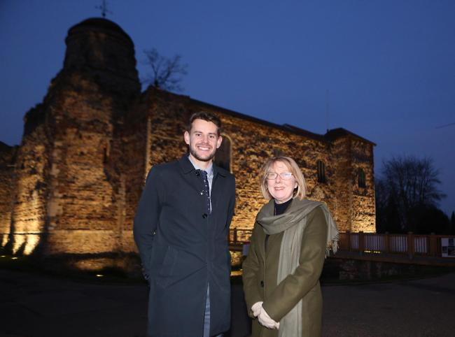 Julie Young and Mark Cory outside Colchester Castle which has been lit up
