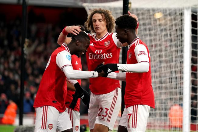 Bukayo Saka, right, is enjoying his football under Mikel Arteta