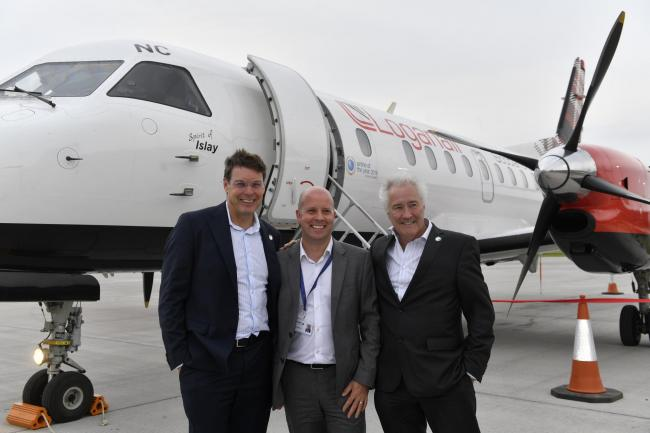Lift off. The first commercial flight from Carlisle Lake District Airport takes off for the first time in more than 25 years. Stobart Group Executives gather for a photograph in front of the Loganair aircraft that had just landed from Southend. (Left to r