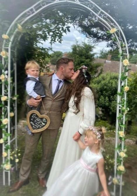 PROMISE DAY: Laura and Dale, with kids Willow and Herbie, celebrate their wedding which never was