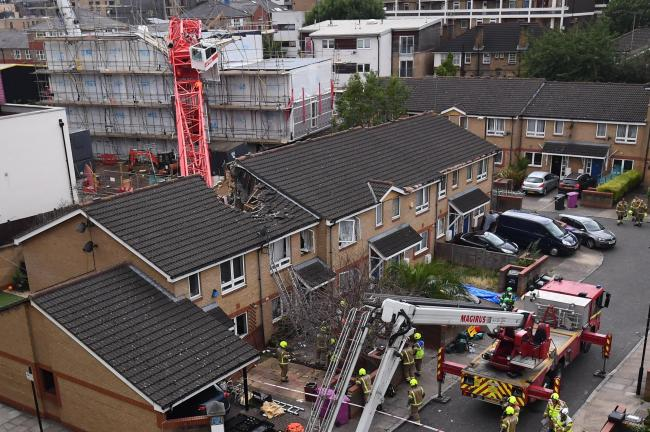 One confirmed dead and others injured as crane collapses on house