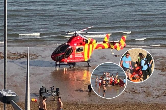 Air ambulance lands on busy beach