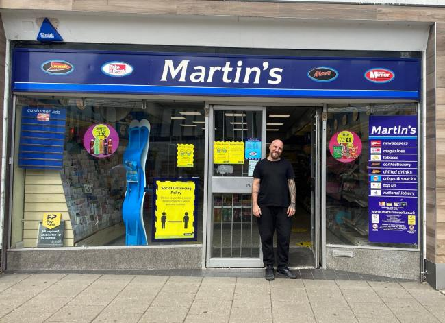 James Dowsett outside the Martin's store in Newland Street, Witham