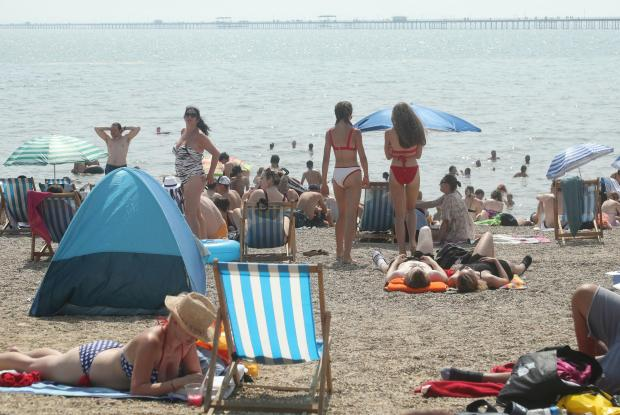 Clacton and Frinton Gazette: Taking a break - visitors on the beach overlooking the pier
