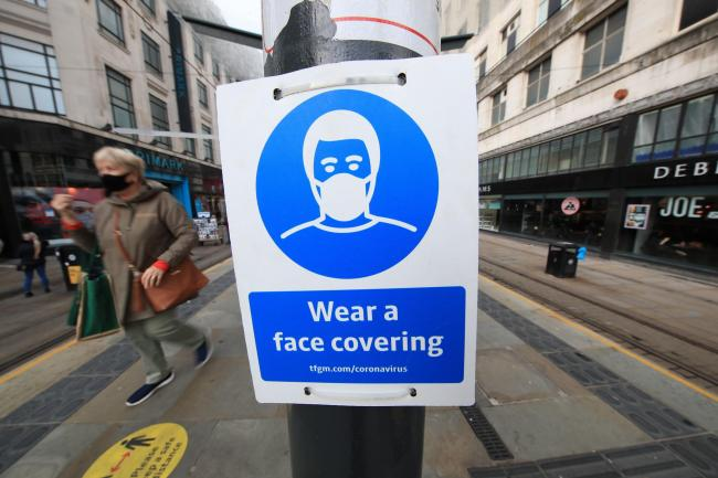 A sign advising on wearing face coverings. Picture: PA