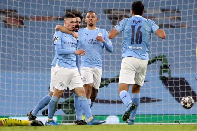 Phil Foden (left) claimed Manchester City's late winner against Dortmund