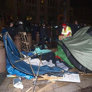 Tents and other structures are removed from the square in front of St Paul's Cathedral