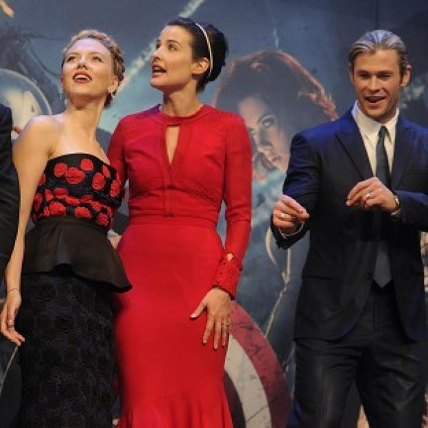 Scarlett Johansson, left, Cobie Smulders and Chris Hemsworth at the Marvel Avengers Assemble European premiere