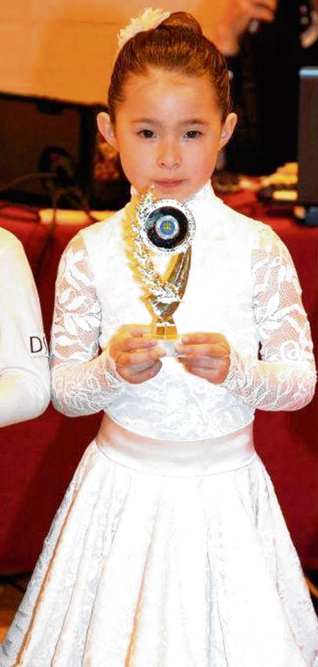 Dance dynamo Mini waltzes into finals