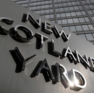 Met Police have arrested a Sun journalist as part of the inquiry into computer hacking