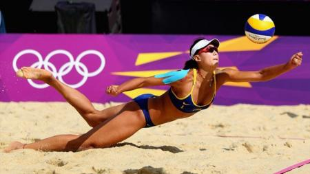 Chen Xue of China helping her team to a 2-1 victory over Switzerland in beach volleyball...