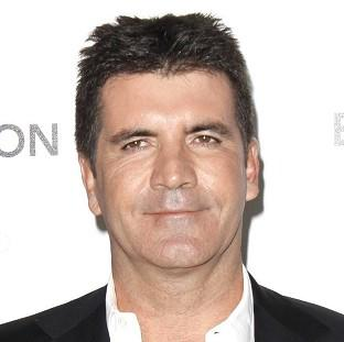 Simon Cowell got a cheeky surprise while on his yacht