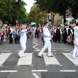 The Paralympic torchbearers recreated The Beatles' famous zebra crossing pose at Abbey Road