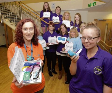 Youth Help Champions at the Colne Community School and College with stop smoking kits Emma Burrows (left) of Colchester and Tendring Stop Smoking with student Natalie Smith, 17.