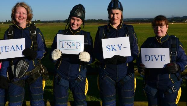 Staff from Thompson Smith & Puxon before their skydive.