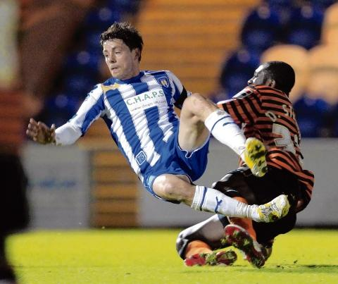 Off the ground - Ian Henderson does battle during Colchester United's 2-0 defeat against Notts County. Picture: STEVE BRADING (CO71067-115)