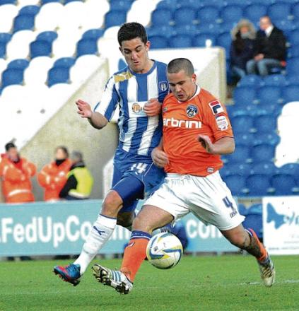 Tussle - U's midfielder Andy Bond battles with Oldham's James Wesolowski during Colchester's 2-0 defeat. Picture: STEVE ARGENT (CO7214-32)