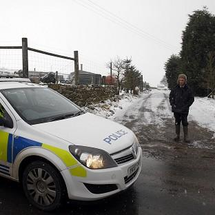 Clacton and Frinton Gazette: Police outside a meat processing plant in Todmorden, West Yorkshire, that was raided as part of the inquiry into the horse meat scandal