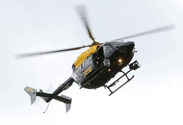Police chopper search for injured man after car crash