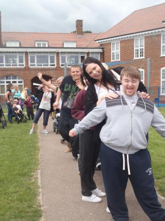 Students raise cash for food banks by staging charity conga