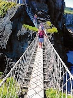 Teacher tackles rope bridge challenge for new library fund