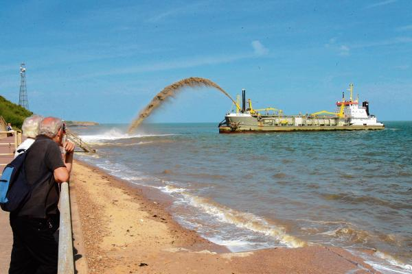 Beaches blasted into existence by 'rainbowing' dredger