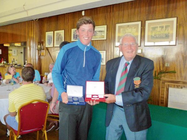 James Taggart receives the Philip Robinson Medal and the Centenary from Frinton Golf Club president Philip Robinson.
