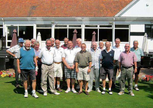 SPECIAL DAY: Clacton Golf Club captain Tony Stevens (in the checkered shorts), surrounded by many of the club's past captains.