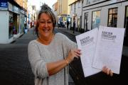 Jo Martin with the petition in High Street, Walton