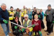 Bra and action figure among mountain of rubbish collected in beach clean up