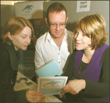 Clacton and Frinton Gazette: More success  Simon Pearce and Frances Beard, of the Thera Group, with Donna Porter at the Gazette Jobs, Careers and Training Exhibition last week.