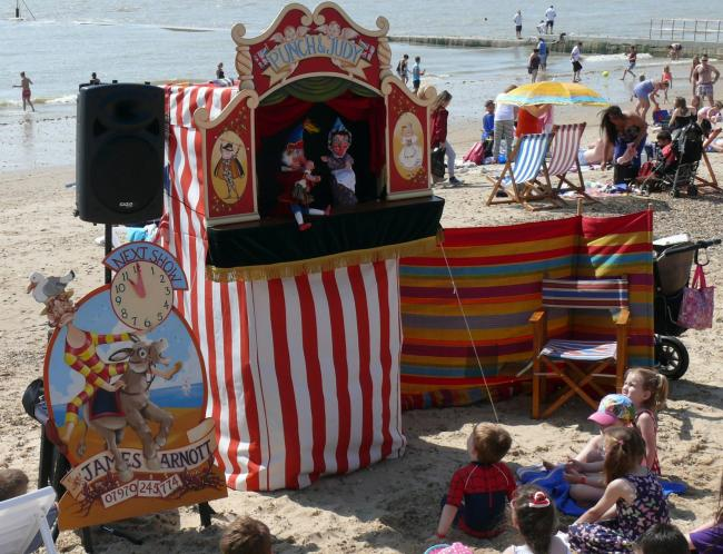 A Punch and Judy show on the beach at last year's festival.