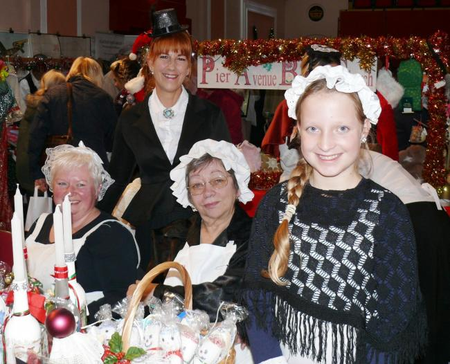 FESTIVE CHEER: Stallholders at last year's Victorian Christmas market.