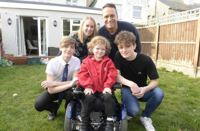 Stanley Newman with brothers Alfie, 14, and Robbie, 17, and parents Rob and Laura