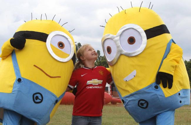 FAMILY EVENT: Chloe Green with a pair of Minions at a previous mega fun day