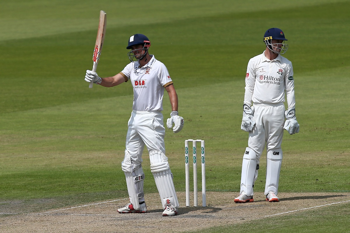 Run king - Essex's Alastair Cook raises his bat to celebrate reaching his 50 during Lancashire Picture: TGS PHOTO/GAVIN ELLIS